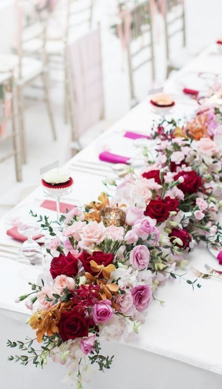 a heavenly bright floral garland in pink, burgundy and marigold plus white is a chic idea