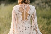 a knee crochet wedding dress with a lace up back, bell sleeves is a lovely idea for a summer boho bride