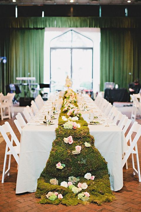 a moss table garland with pastel blooms will do for a tea party wedding or an Alice In Wodnerland one