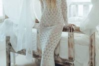 a relaxed boho beach off the shoulder crochet wedding dress with long sleeves and fringe is a lovely and dreamy idea for a free-spirited bride