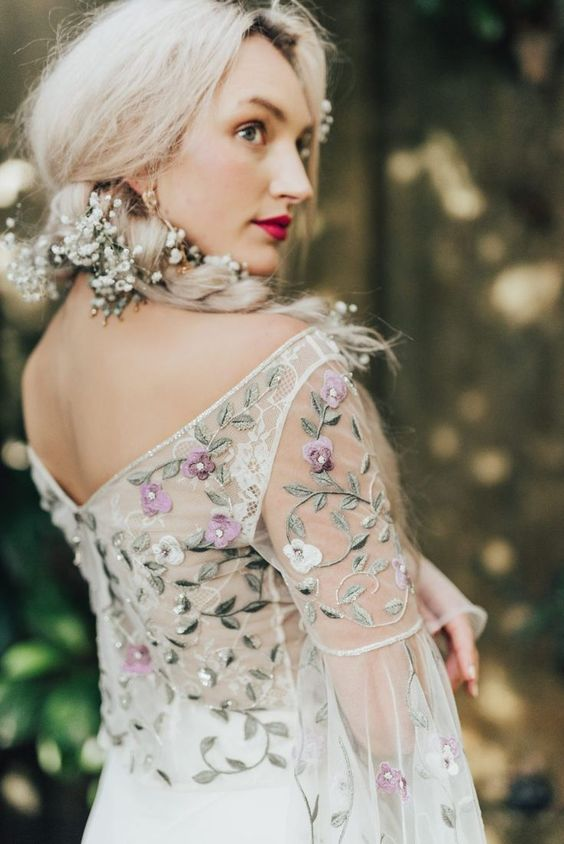 a romantic off the shoulder wedding dress with pretty detailing - mint, white and purple floral embroidery
