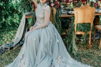 a romantic powder blue wedding dress with blush floral appliques and a train is a fairy-tale piece
