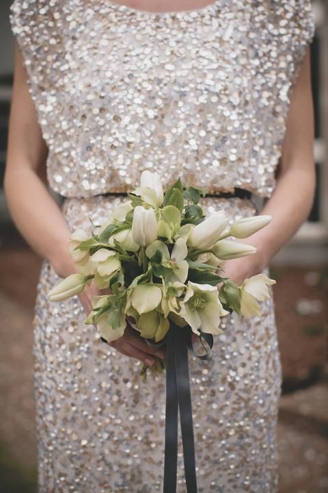 a silver chunky sequin wedding dress with a high neckline, cap sleeves looks super glam, chic and bold
