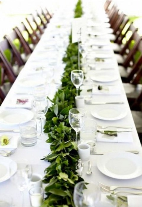 a simple greenery table garland will refresh your neutral tablescape, even if you have an all-white wedding