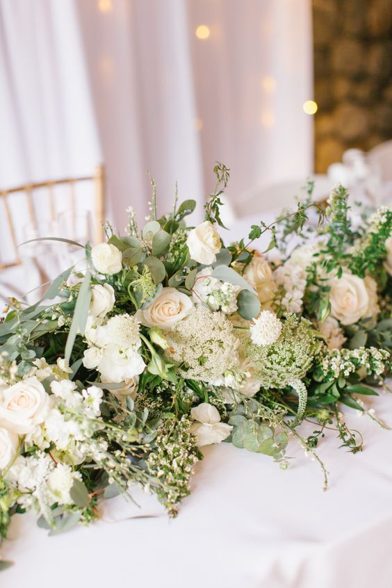 a super lush greenery and neutral bloom wedding table garland will make a beautiful statement in decor