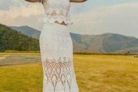 a two piece crochet wedding dress with cap sleeves, a crop top and a maxi skirt for a wild wedding in boho style