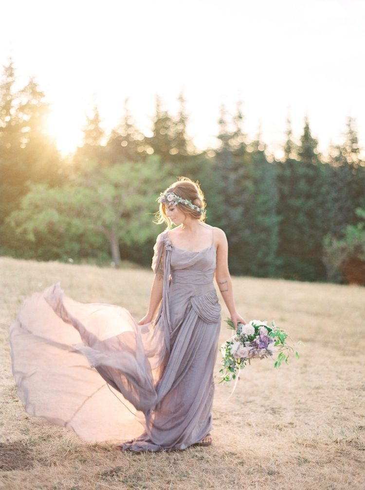 a unique purple draped wedding dress, a tender blush and lavender wedding crown and a romantic lavender and blush wedding bouquet
