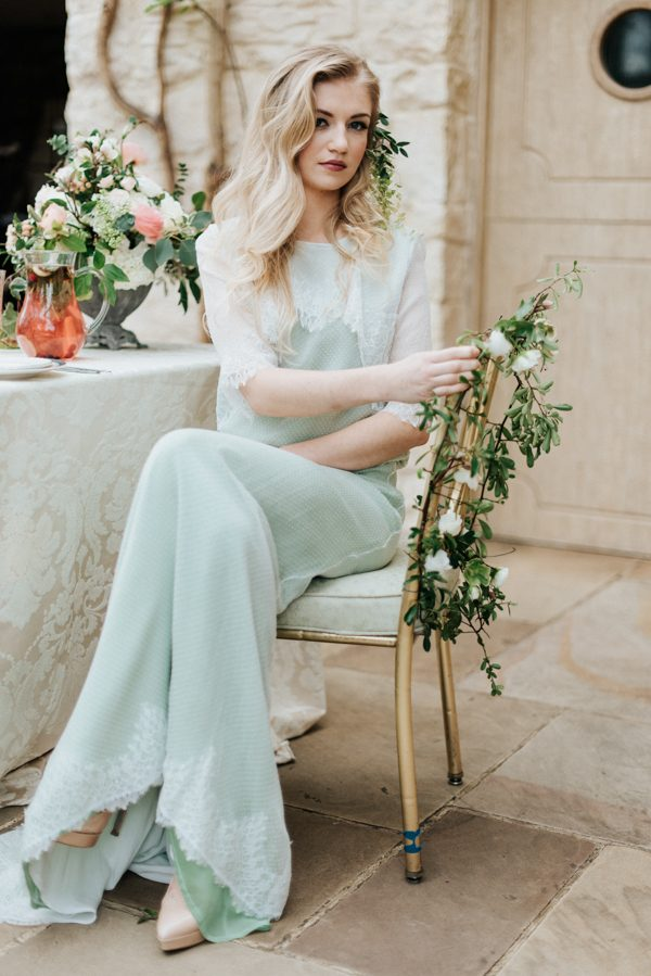 a vintage-inspired mint-colored wedding dress with lace detailing and edges for a non-traditional bride