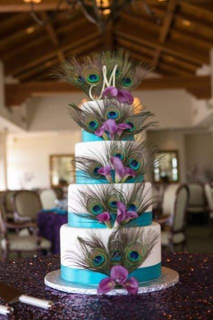 Picture Of A White Wedding Cake With Turquoise Ribbons Peacock Feathers And Purple Orchids For Decor