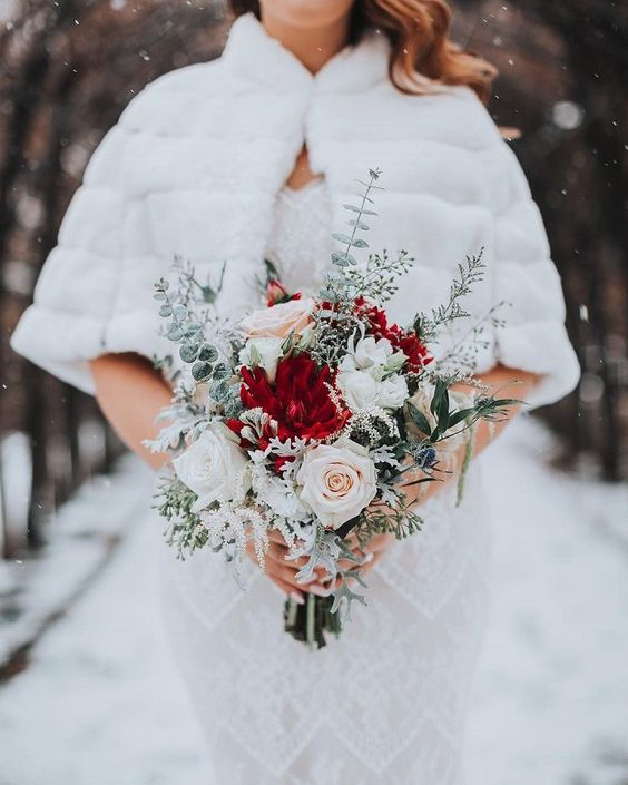 an ethereal Christmas wedding bouquet of blush, white and red blooms and pale and snowy foliage is amazing