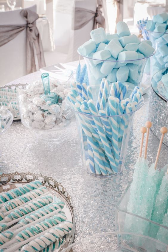an ice blue and silver winter wedding dessert table is a gorgeous and bold idea for a winter celebration