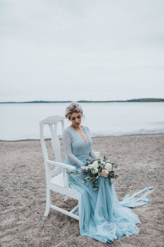 an ice blue winter wedding dress with a lace bodice and a layered skirt with a train is a gorgeous idea to rock