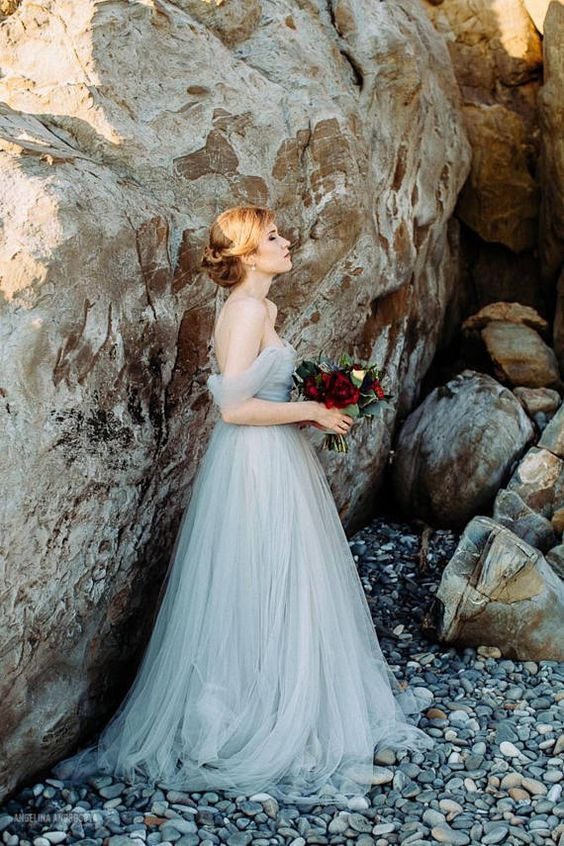 an off the shoulder ice blue wedding dress with a draped bodice is a beautiful idea to go for
