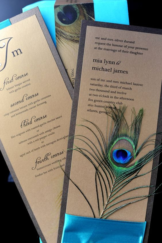 bold cardboard wedding invitations with turquoise ribbons and peacock feathers for a catchy look