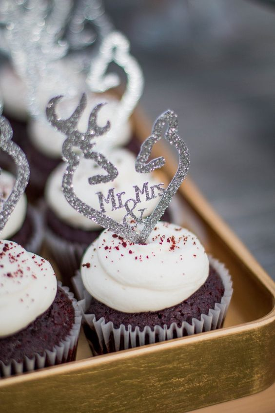 chocolate cupcakes topped with pretty silver glitter anlters are amazing for a woodland wedding