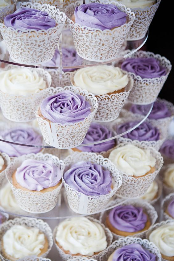 elegant wedding cupcakes with white and purple icing in laser cut liners are very chic and stylish