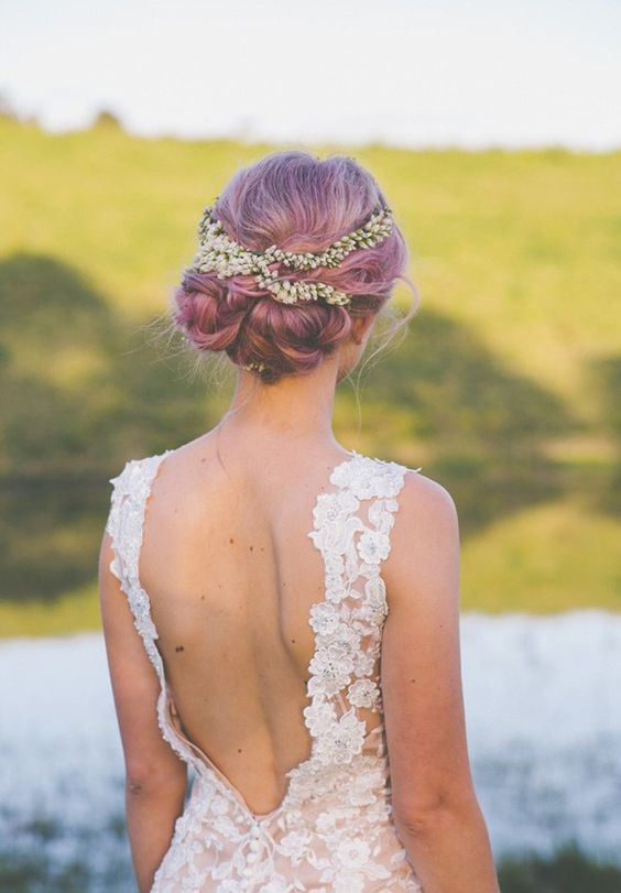 purple wedding hair in a cute braided low updo with a floral crown for a romantic bride