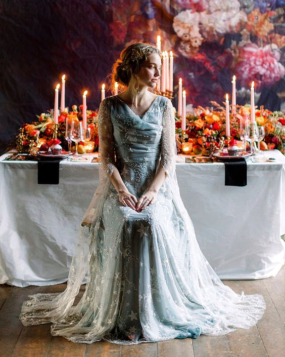 a blue star embroidery wedding dress with a draped bodice, long sleeves and a train for a fairy tale bride