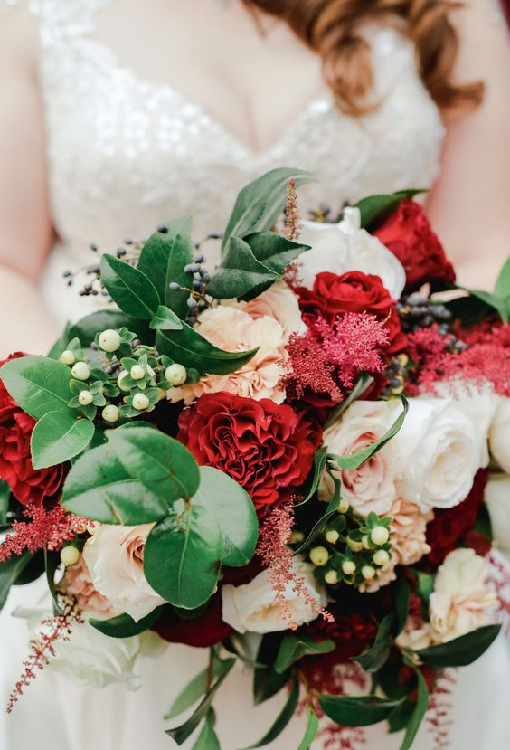 a bold and chic wedding bouquet with white, blush and burgundy blooms, greenery and berries for a winter wedding