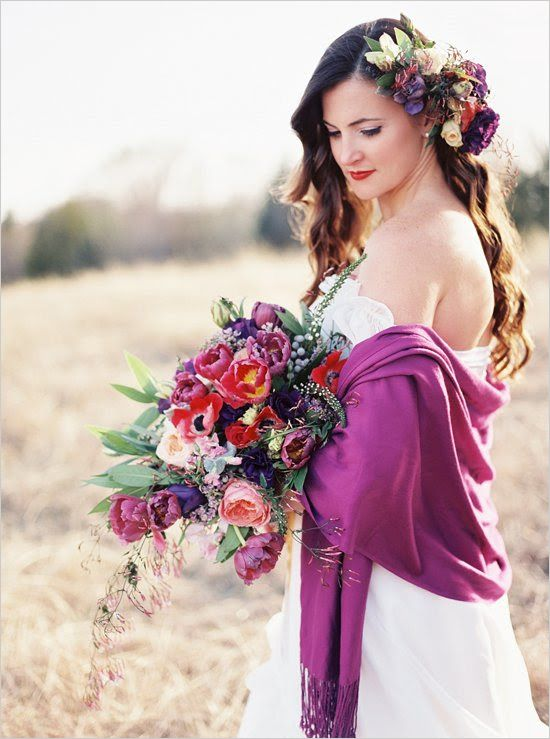 a bold bridal look with a radiant orchid coverup and super bright blooms in her hair and in her bouquet just wows