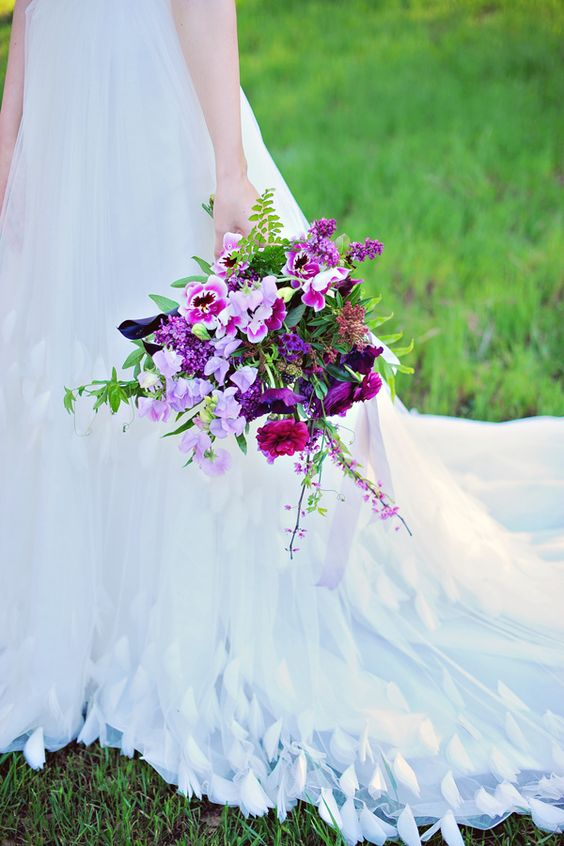 a bold radiant orchid and hot pink wedding bouquet with greenery is a lovely idea to go for