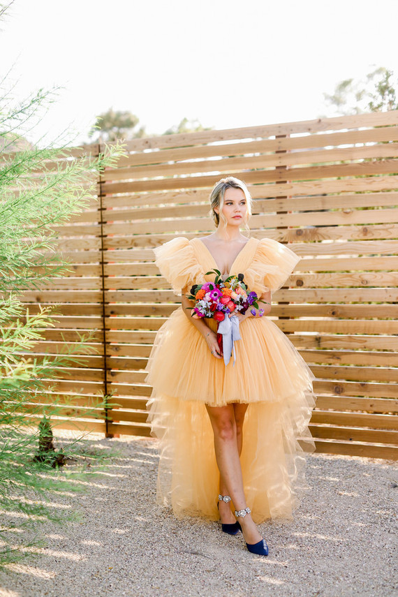 a breathtaking yellow tulle high low wedding dress and navy shoes with floral detailing for a jaw-dropping look