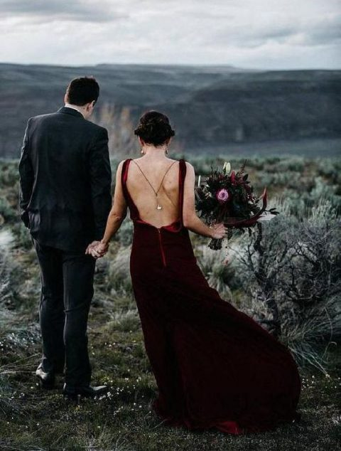 a burgundy velvet wedding dress with a train and a cutout back plus thin straps, a back necklace for a statement