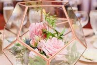a faceted rose gold terrarium with pink blooms, thistles, greenery is a beautiful wedding decoration or centerpiece