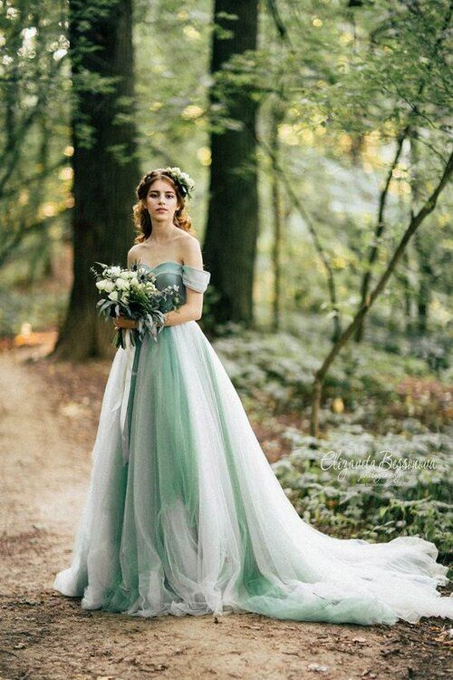 a fairy-tale-like green off the shoulder wedding dress in light green and white and with a train is a beautiful idea