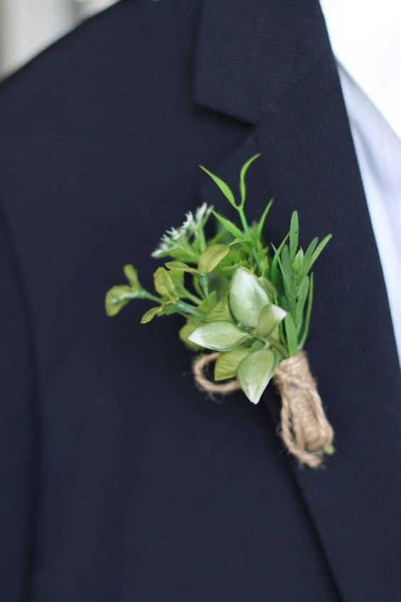 a greenery and white bloom boutonniere with a twine wrap is a simple and natural accent to your look