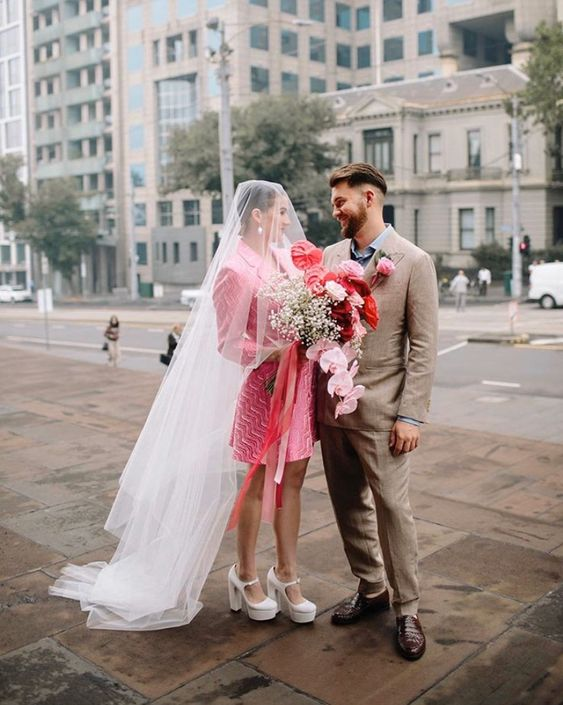 a hot pink blazer wedding dress, platform shoes and a veil for an out of the box and super bold look