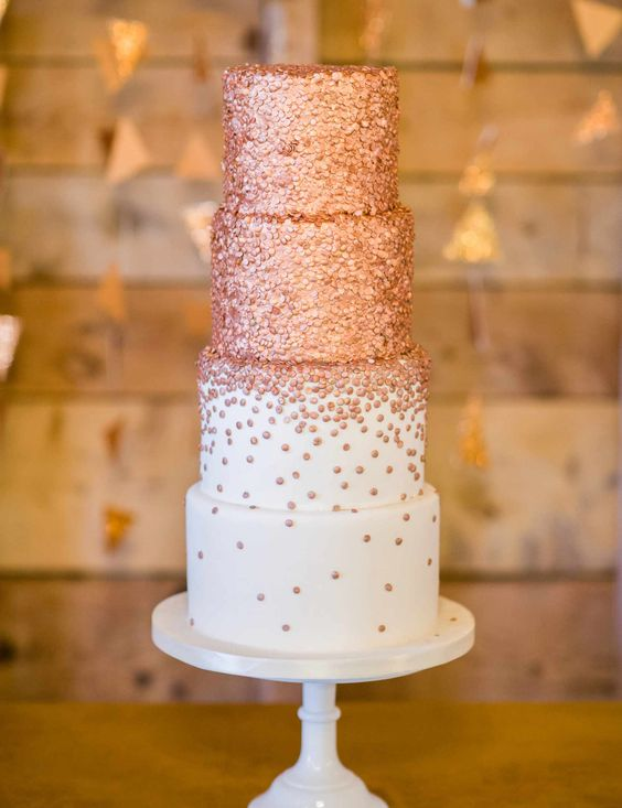 a large wedding cake with rose gold dots is a bold and chic idea for a modern glam wedding