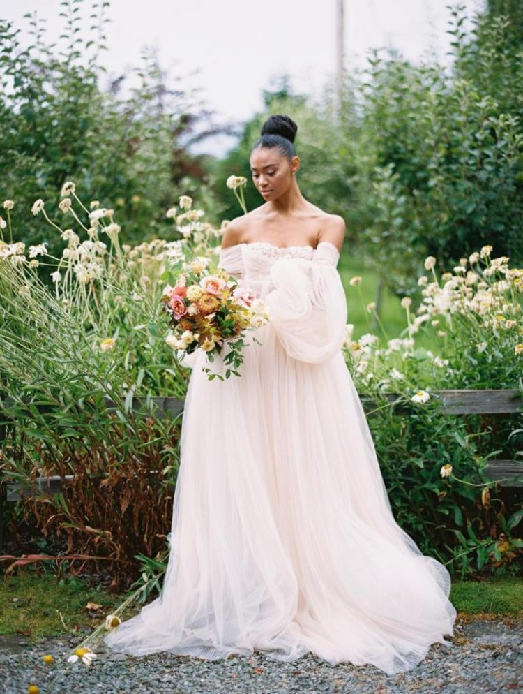 a refined flowy off the shoulder blush wedding gown will make you look like a fairy tale princess