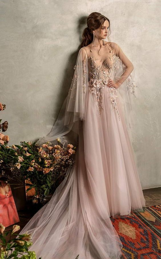 a refined light pink A-line wedding dress with embroidered and floral applique bodice, a pleated skirt and long embroidered sleeves