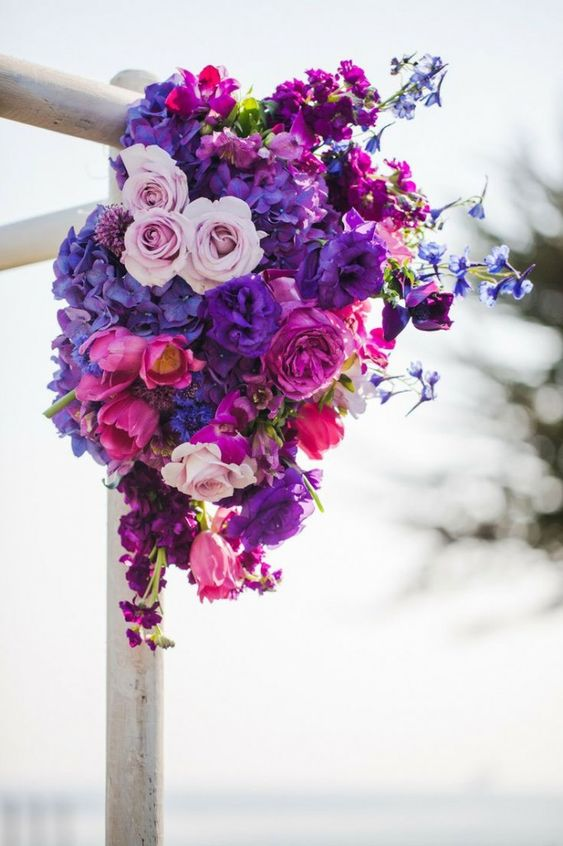 a super bold radiant orchid, hot pink and blush floral arrangement decorating a wedding arch is a very refined idea