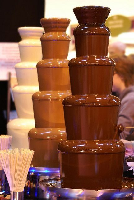 a trio of chocolate fountains - a black, a milky and a white one is a lovely and refined idea for every type of wedding