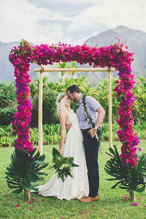 a simple yet gorgeous wedding arch inspired by tropics