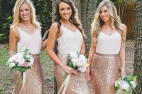 bridesmaids wearing separates – white tops and rose godl sequin maxi skirts and rose gold necklaces