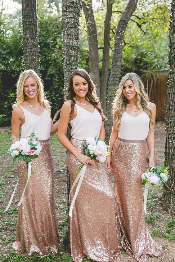 bridesmaids wearing separates - white tops and rose godl sequin maxi skirts and rose gold necklaces
