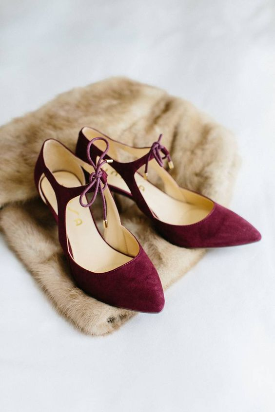 burgundy shoes with cutouts and ties are a great vintage-inspired idea for a winter bride