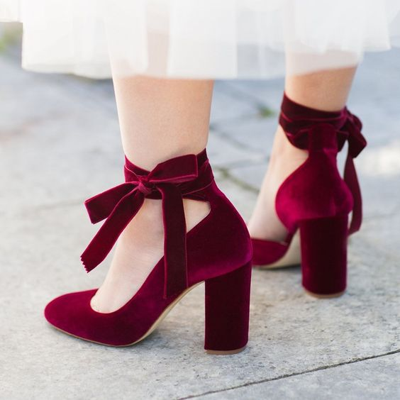 burgundy velvet shoes with ties and bows on the ankles look amazingly girlish and very chic