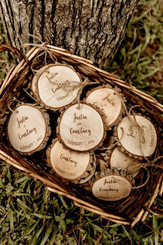 burnt wood slices can act as coasters and are a good and budget friendly idea for any rustic wedding including a Christmas one