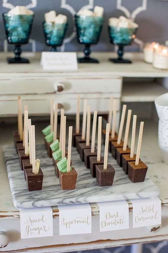 chocolate popsicles on sticks with various tastes and additions plus mint touches are lovely wedding desserts