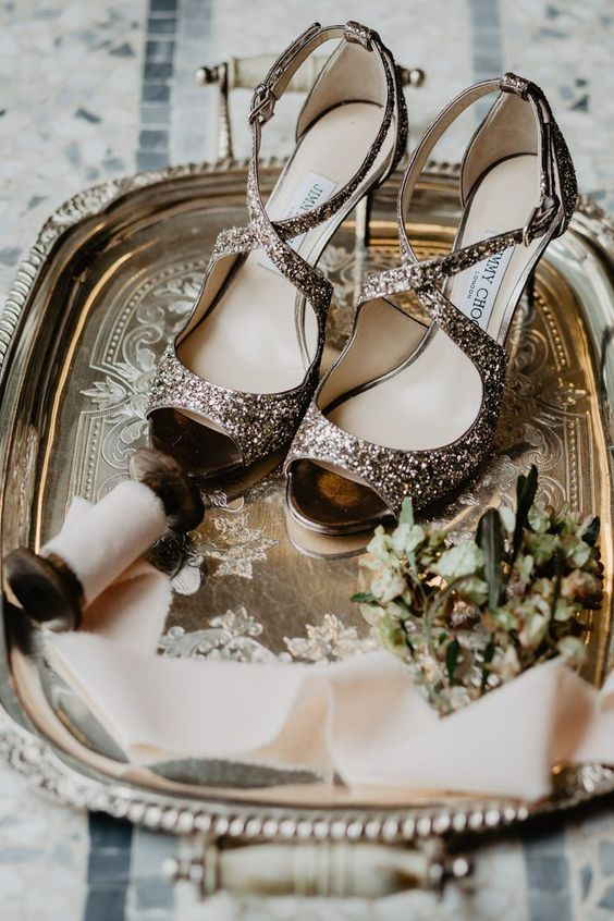 glitter strappy Jimmy Choo shoes are great for a shiny and sparkling winter bridal look