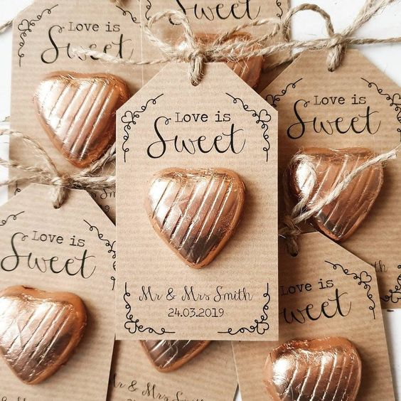 heart-shaped candies with personalized cardboard tags are lovely wedding favors to try