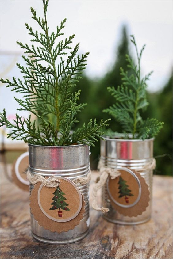 mini Christmas trees in tin cans and with cool tags are great Christmas and winter wedding favors for a rustic celebration