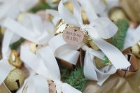mini glitter bells with tags and ribbon bows are gorgeous holiday-inspired wedding favors to rock