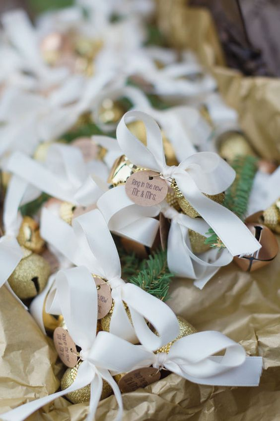 mini glitter bells with tags and ribbon bows are gorgeous holiday inspired wedding favors to rock