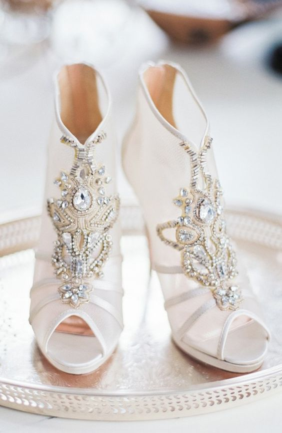peep toe sheer bejeweled booties with heavy embellishments look very glam and amazing