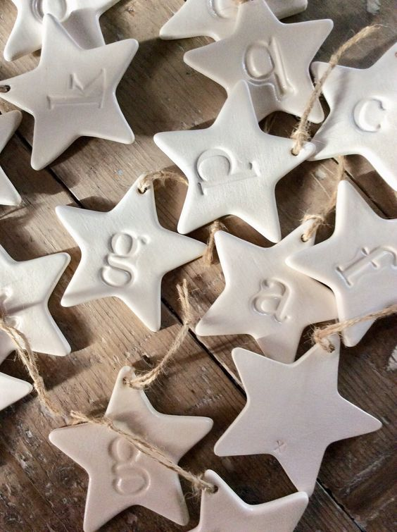 white clay star-shaped ornaments with monograms are amazing for Christmas, make them yourself